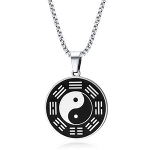 Yin yang pendant necklace hanging on a silver box chain