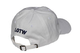 Side view of white LOTW GEAR dad hat with navy blue embroidered logo