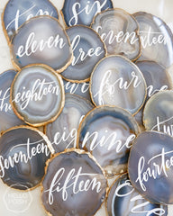 light gray agate with gold gilded rims and white text