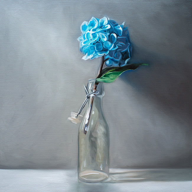 Glass Bottle of Blue Hydrangeas