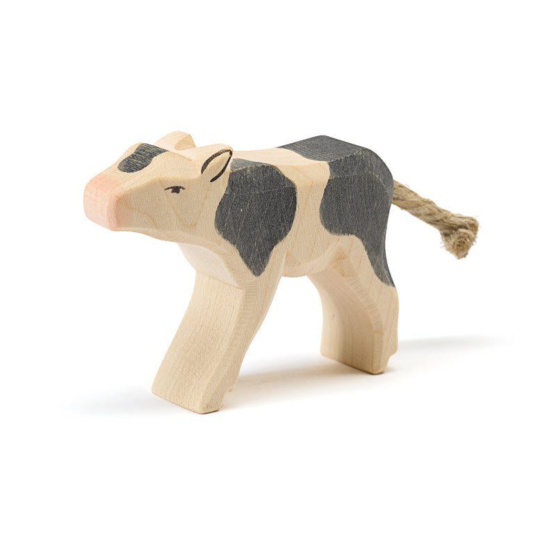 Black and White Calf Drinking Wooden Toy