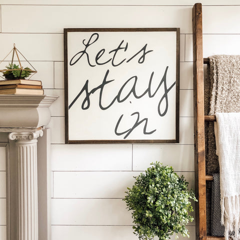 """Let's stay in"" 2'x2' wooden sign"