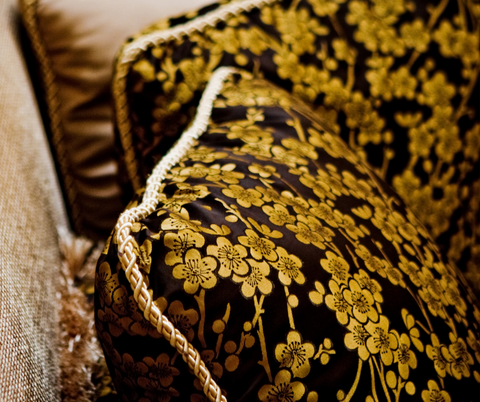 A Picture of Silk used as a upholstery fabric in a home as a home decor accessory for a blog post on leelathestore.com