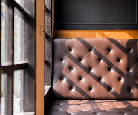 A Leather Couch depicting the use of leather upholstery in a home on a blog on leelathestore.com