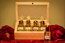Load image into Gallery viewer, A collection of four floral scents contained in a wooden box.