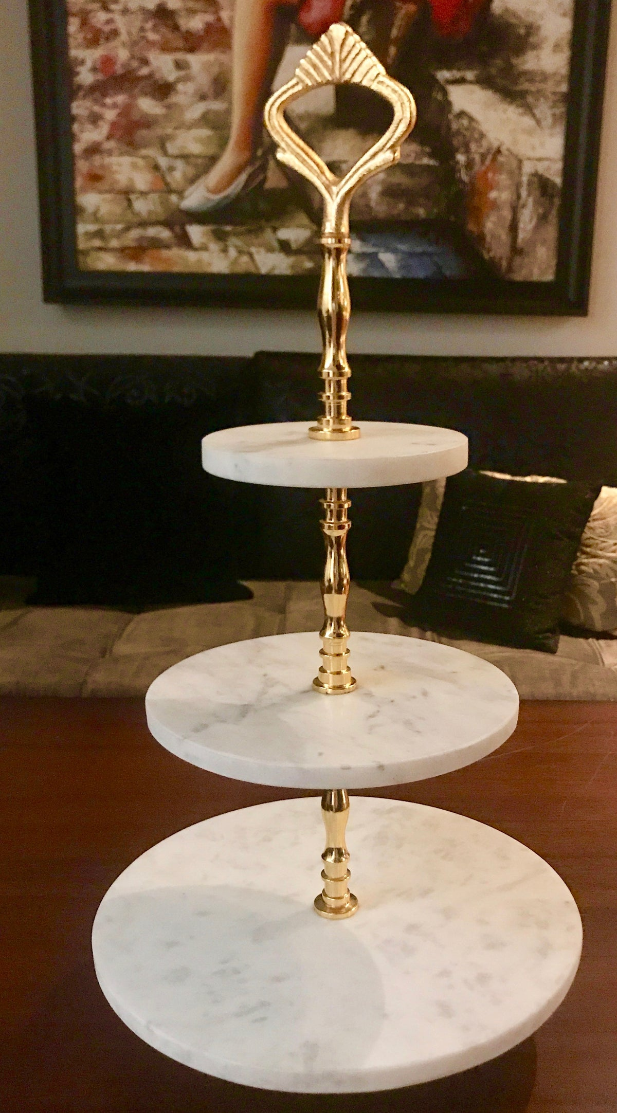 A Marble cake stand with a brass stem with 24ct polish to support the structure.