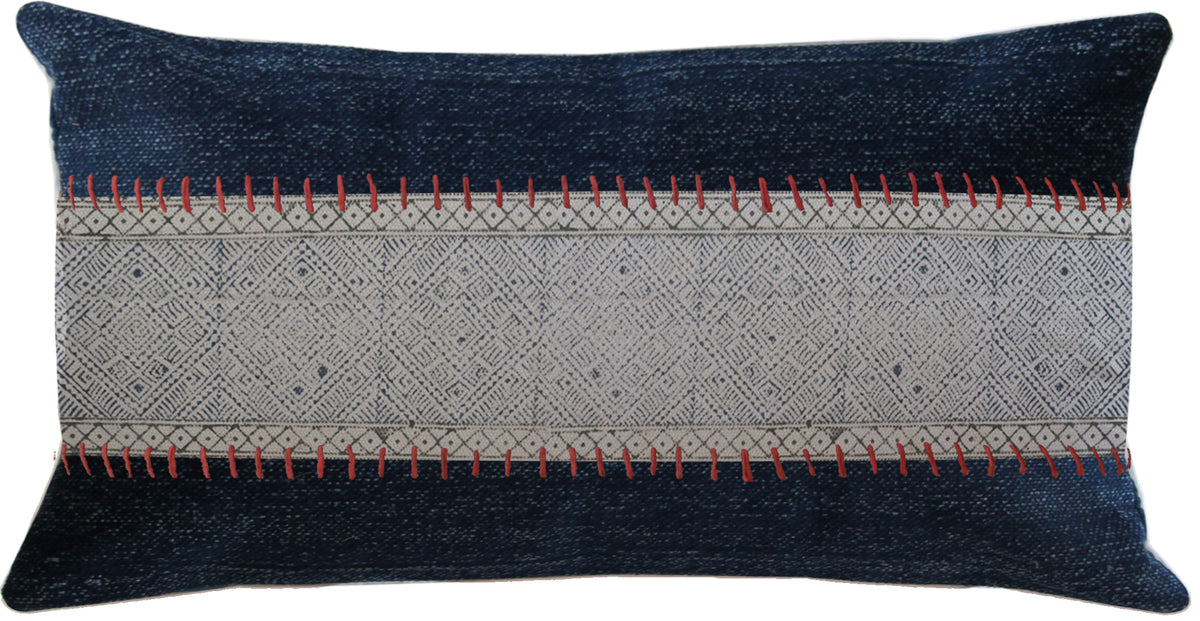 A night blue rectangle cushion, made with 100% cotton comprising of a red and grey pattern detail in the centre & goes with mostly all interior styles.