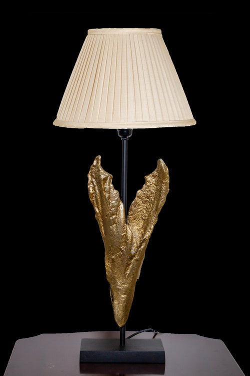 A gold Lamp with defined detailing of a leaf design that works best with traditional & modern or contemporary interior style. A perfect home decor product for your beloved home.