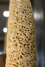 Load image into Gallery viewer, A true object d'art. Carved on a camel bone, the intricate work is inspired by carvings done in ancient times as a symbol of wealth & privilege. A single tusk is majestic on a consol
