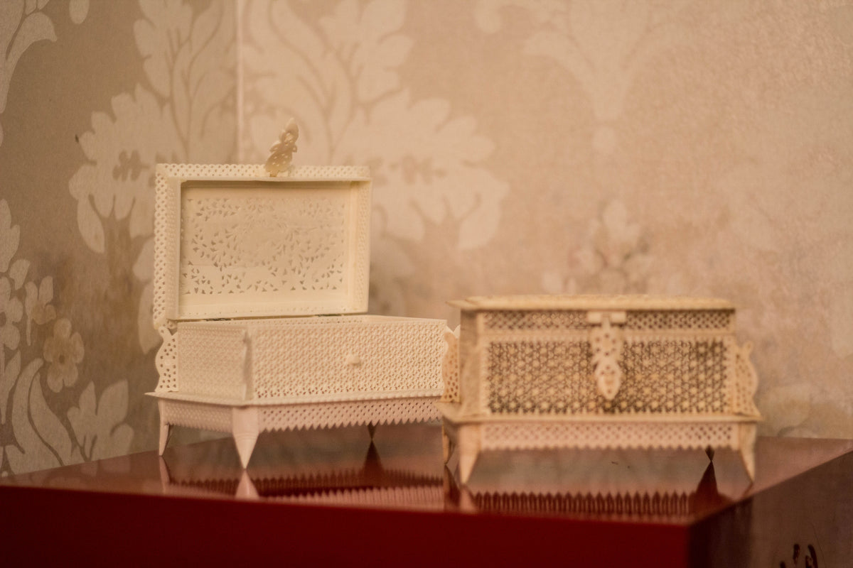 a beautifully hand caerved white marble dust box with each box depicting different forms of wildlife animals.