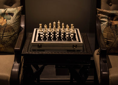 An elegant and tieless camelbone chess set, with black and white chess piece.