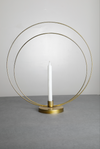 A gold Loop Candle Stand with gold coating and a candle holder in the centre