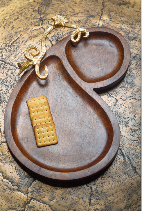 A Kebab Platter made with pure mango wood with two sections for different foods, along with a gold leaf handle detail.