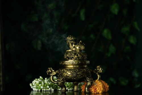 A brass incense burner with an antique gold finish to decorate your home this diwali
