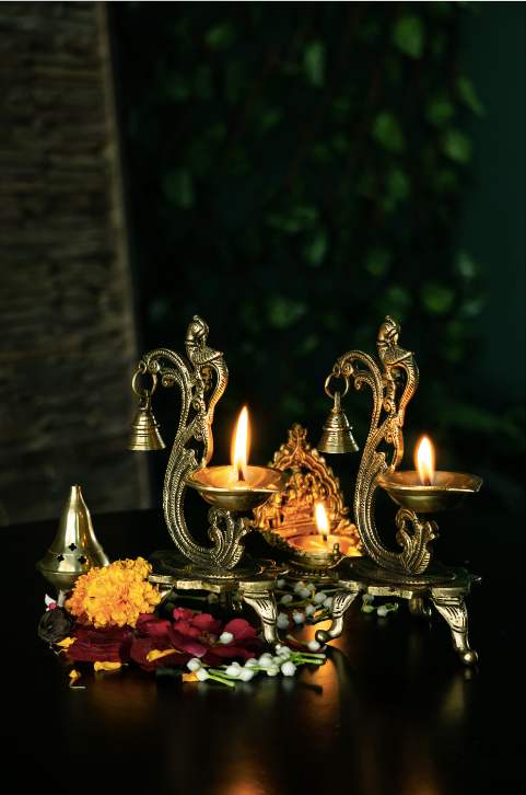 Brass Diyas with a bell Detail with an antique gold finish.