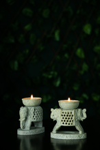 Load image into Gallery viewer, A soap stone elephant  candle stand with a jaali detail for this Diwali Decor