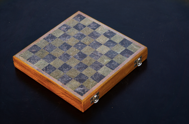 With a Marble set onto a wooden base, this chess set is skilfully carved by our talented Indian Artisan. A provision to store the Hand Cut Marble Playing Pieces complete with a velvet protective casing