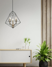 Load image into Gallery viewer, A black ceiling pendant light with a wired metal frame with three gold bulb portals within the frame.