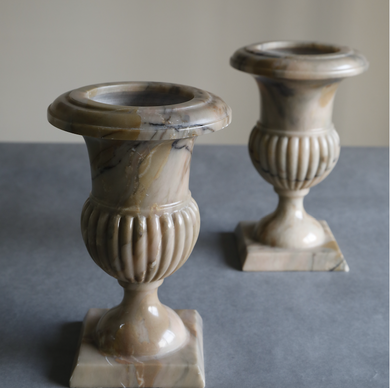 Hand Carved marble chalice glass decoratives with a stand at the bottom.
