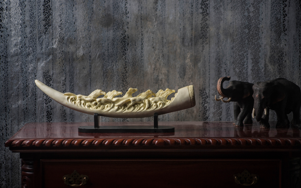 A White Camel Bone tusk, carved with hand, depicting the forest animals & taking inspirations from the various artistic caves of India