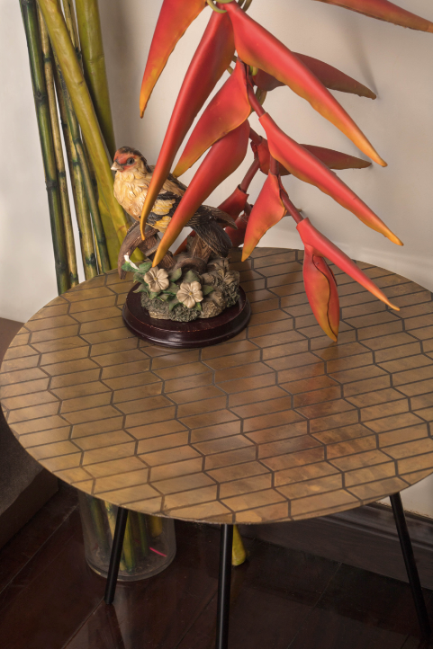 A Brass Table is topped with a geometric pattern.