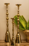 A gold & chrome tall candle stand set of 3, perfect decor accessory for the home decor enthusiast.