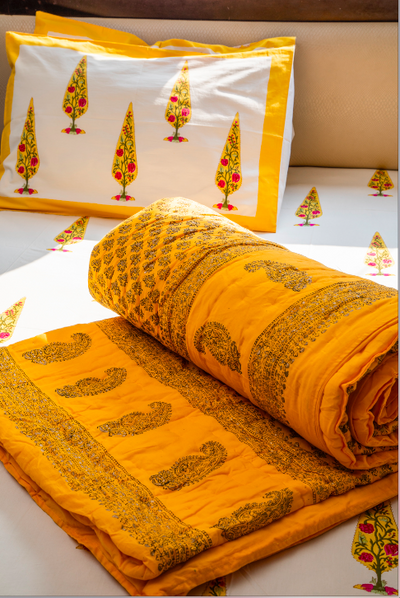 A bright yellow quilt, which makes going to bed more & more attractive than it already is. King Size. 100% cotton, Washable, Handprinted.