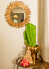 A gold mirror embodying the design of a cluster leaf arrangement, bringing glamour to every wall it adorns.