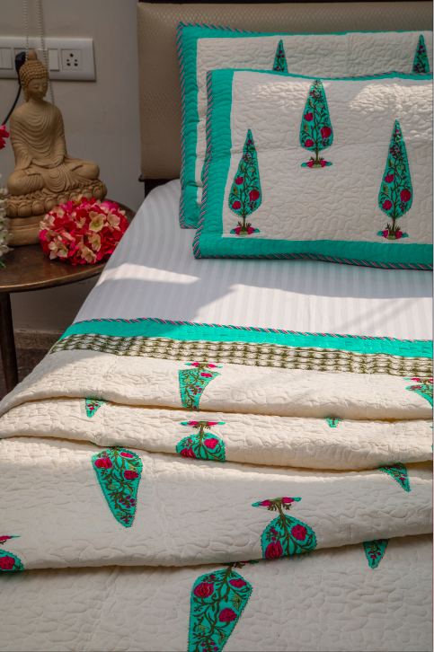 A king size bedcover along with 2 pillow covers, made from a 100% cotton and 100% machine washable.