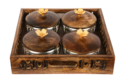 A wooden tray with a Jaali carving detail, along with 4 jars, perfect for all condiments and completely food safe.
