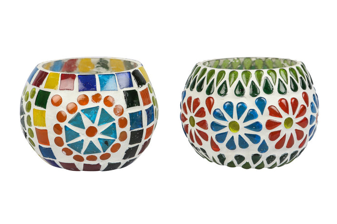 A Colourfull blue pottery tea light holder, with multicoloured glass work on the exterior.