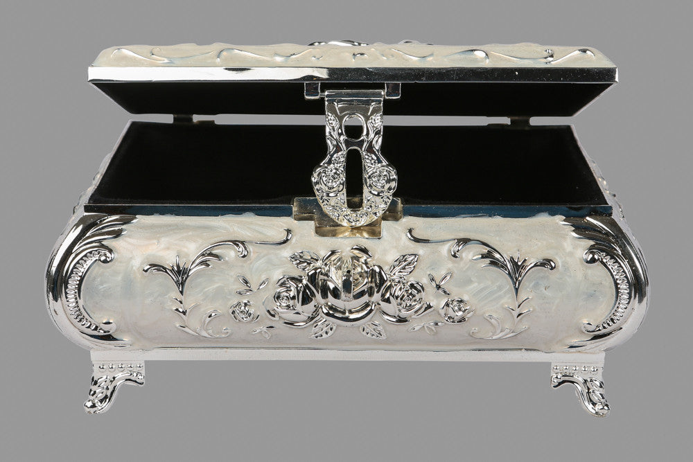 A silver box with carvings, perfect for gifting purposes or for storing  of refreshments.