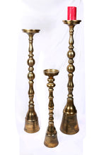 Load image into Gallery viewer, A gold & chrome tall candle stand set of 3, perfect decor accessory for the home decor enthusiast.