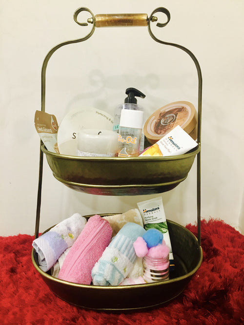 A brass bathroom decorative basket made for storing hand towels and other bathroom essentials.