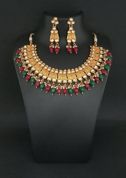 Tanishka Fashions Kundan Stone Copper Necklace Set