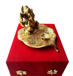 Gold Plated Leaf Ganesh with Diya God Idol with Beautiful Velvet Box Packing Exclusive Gift for Birthday Gift, Corporate Gift and Wedding Gifts $ IGSPBR1093