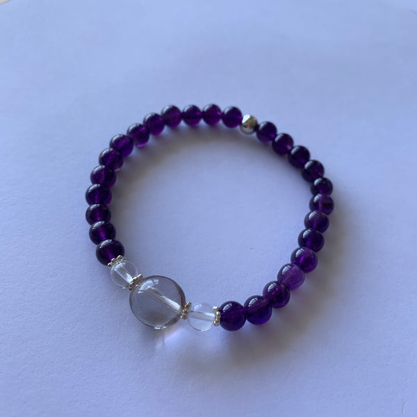 Amethyst, Smokey Quartz and Clear Quartz stretch bracelet with sterling silver beads