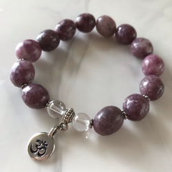 Lepidolite and Clear Quartz stretch bracelet with an Om symbol charm
