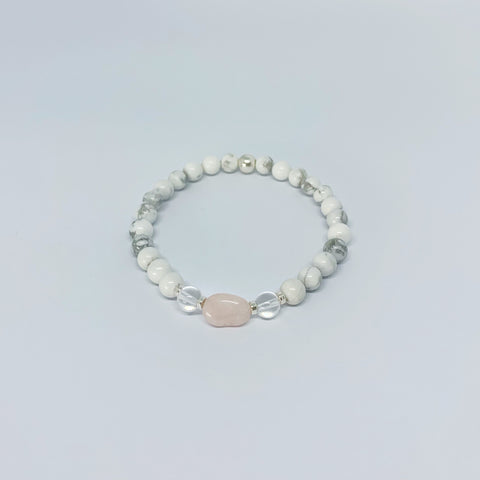 Howlite, Morganite and Clear Quartz stretch bracelet with sterling silver beads...