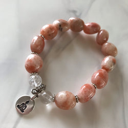 Sunstone and Clear Quartz stretch bracelet with a Buddha charm