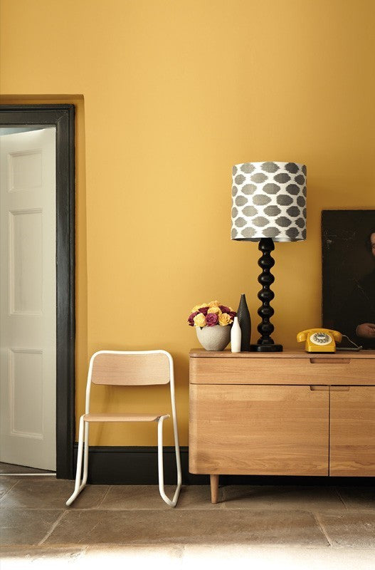 Yellow Wall, Black Door Frame and Black Accessories