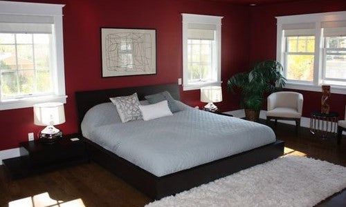 Dark Red Wall And Modern Bed