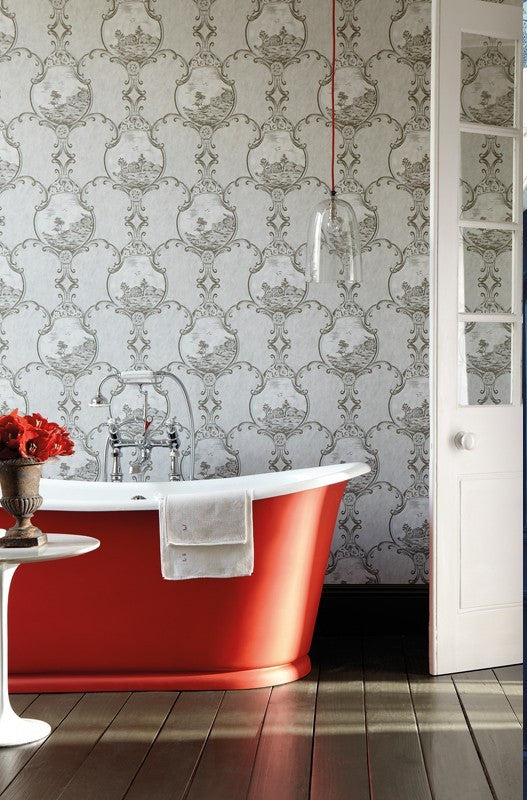 Red Bathtub In Front Of Grey Wallpaper