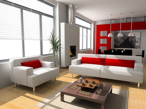 Red Cushions And Background Wall In A Modern Cream Living Space