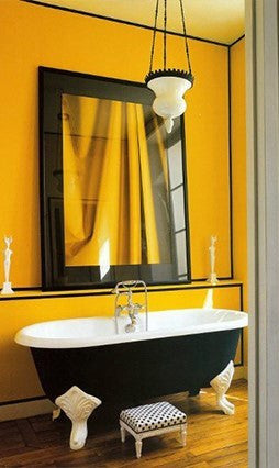 Yellow Bathroom With Black Bathtub And Accessories
