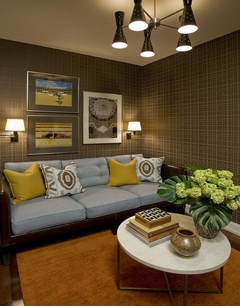 Golds And Yellows In Funky Living Space, With Orange Rug And Brown Patterned Wallpaper