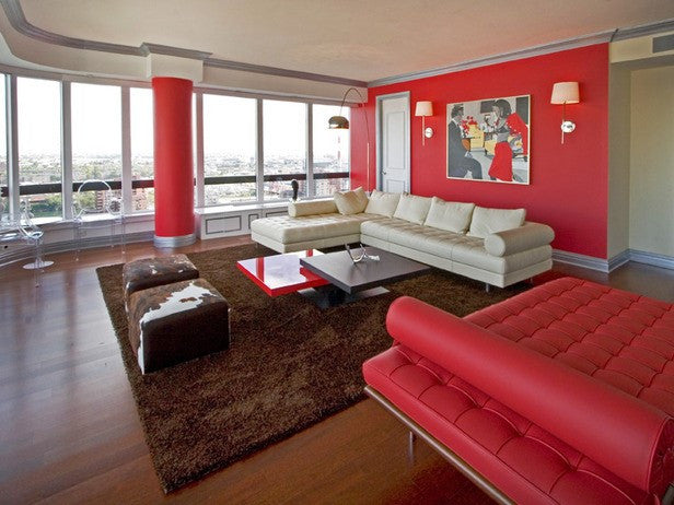 Red Walls, Column And Sofa In A Living Room
