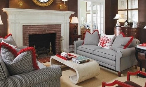 Grey Sofa In Stylish Living Room With Red Trim On The Cushions