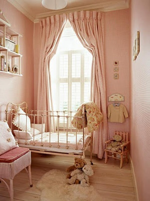 Contemporary light pink nursery with white metal cot bed