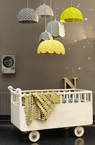 Brown nursery with knitted lampshade in brown, grey, light green and yellow